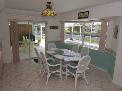 dining area with view of canal