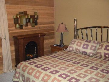 Master bedroom has king bed, electric fireplace and its own private full bath