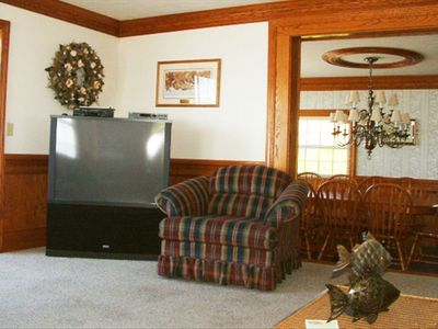 Large TV and a dining room that can seat a large family together.