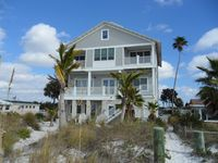 Welcome to Paradise! Custom Built 3-story Home is Located Directly on the Beach!