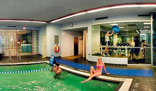 Vancouver house photo - Indoor Pool with Fitness Center Behind at the Club Intrawest Vancouver Resort