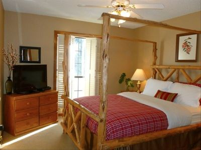 Beautiful first floor bedroom w/ queen log bed