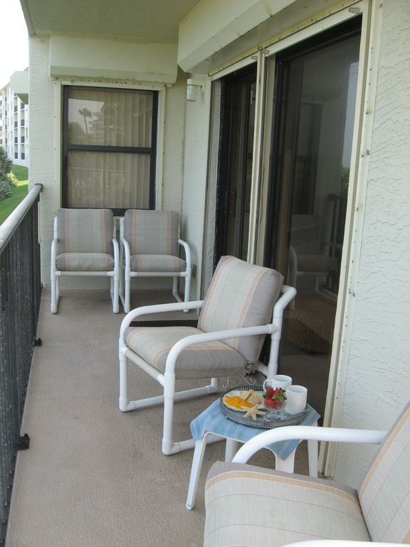 Balcony has seating for four