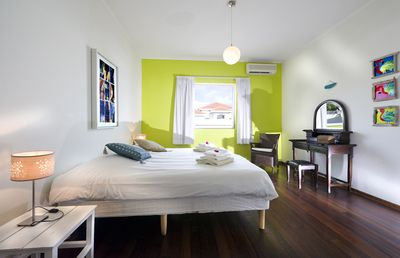 Green bedroom with AC