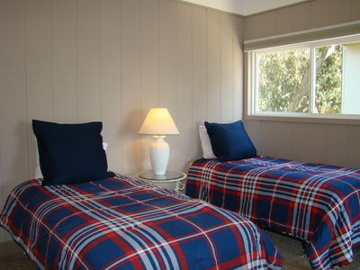 One of the downstairs bedrooms. Each bedroom has two twin beds, flat-screen TV