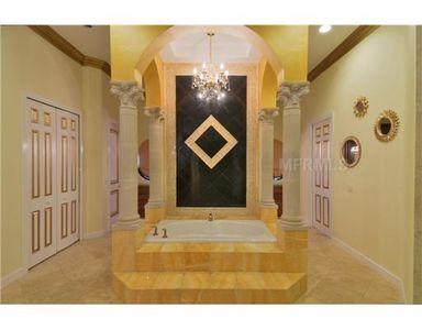 Master Bath with His/Her Closets, Vanities and Toilets