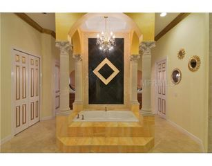 Tampa house photo - Master Bath with His/Her Closets, Vanities and Toilets