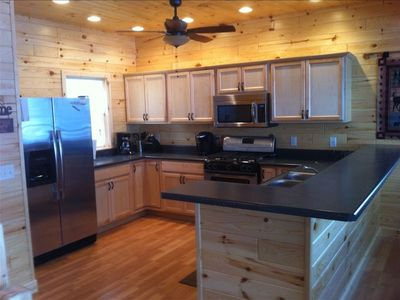 Fully equipped kitchen has sparkling new appliances, open to Great Room & Deck.