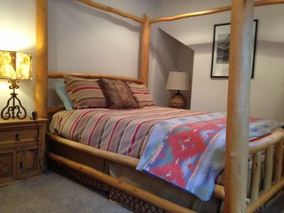 Guest House master bedroom; queen bed from aspen logs