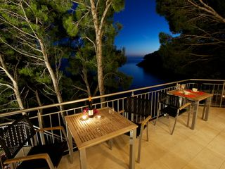 Milna villa photo - Outdoor terrace overlooking the sea