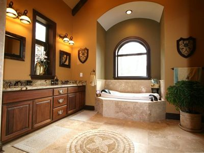 1 Master Bathroom with jacuzzi and large shower.