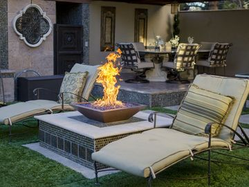 Relax by the fire pit with a cool drink!