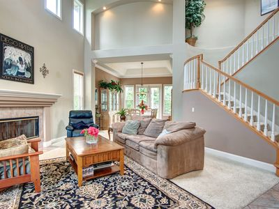 Bright and sunny Living Room with cathedral ceilings and Dining Room.