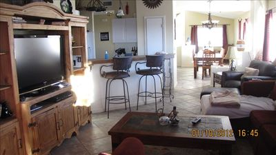 Great room with HD TV. Breakfast bar and kitchen. Porcelin tile for easy care.