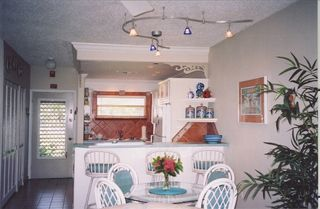 Grand Cayman condo photo - Dining area through to the kitchen