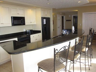 Breakfast bar and fully equipped kitchen.