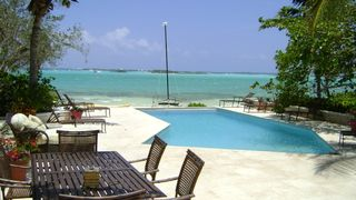 Great Exuma villa photo - Common pool and beach area, just steps from the villa.