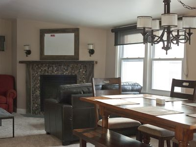 Gas fireplace and a cozy seating area for watching television.