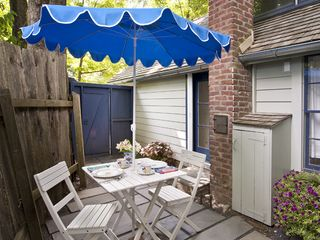 Woodstock studio photo - Herb Cottage: private kitchen patio for morning coffee or evening cocktails