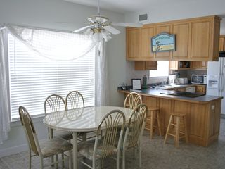 Gulf Shores house photo - Open kitchen and dining area with seating for 3 at breakfast bar.