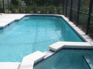 Windsor Palms house photo - Jetted spa area at the shallow end of the pool