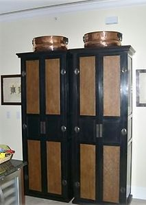 Antique Rattan Cabinets house the Bar and serving pieces