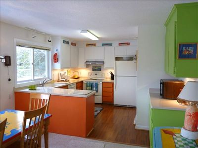 Bright, colorful kitchen with great views of waterfront.