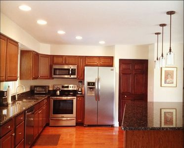 Roomy Kitchen With Massive Countertop Island, Open To Living, Dining Room & Pool