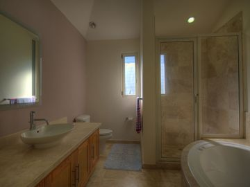 Main floor master bath with jetted soaker tub.