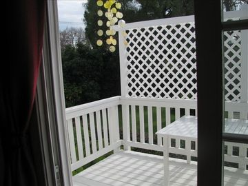 Outdoor deck with table and chairs.