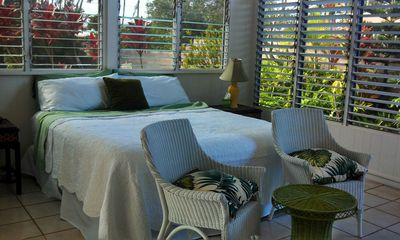 Lush tropical gardens surround the space while the gentle breeze cools you.