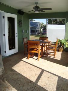 Screened Lanai with teak table with seating for four; also a grill & lawn chairs