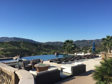 Temecula estate rental - 1500 sq ft white marble terrace with infinity pool and swim up bar