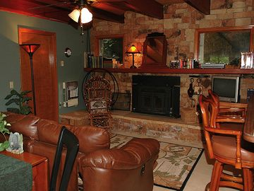Both living rooms feature stone hearth fireplaces (firewood included!)