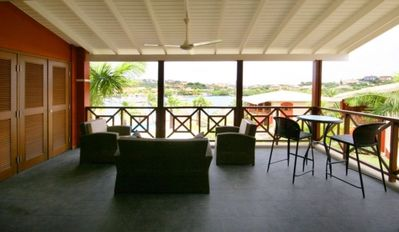 Spacious veranda with views of Spanish Water. Enjoy outdoor living!
