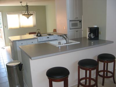 Kitchen equipped with microwave, stove, refrigerator and dishwasher