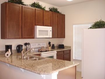 Upgraded Kitchen with granite, glass top stove, ice/water dispenser refrigerator