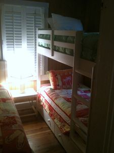 Back bedroom -- one set of bunk beds and one extra twin. Sleeps three.