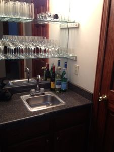 Wet bar off the kitchen for preparing drinks apres ski
