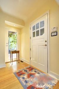 Foyer with door leading to south facing terrace.