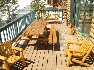 Wrap Around Deck With Log Furniture and Gas Grill As Seen From Hot Tub