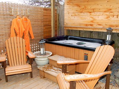 ENJOY A GLASS OF WINE  AND A DIP in the HOT Tub