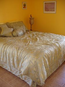 """The Yellow Room"" with queen size bed, large closet, and water view."