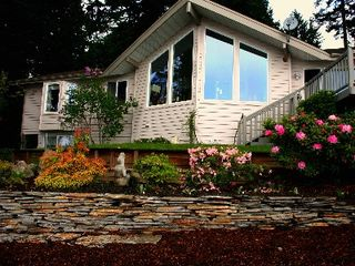 Shelton house photo - View of Agate Beach House from water side garden. Cathedral living room windows.