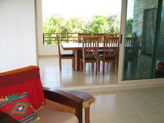 Tulum condo photo - Indoor and outdoor dining for eight.