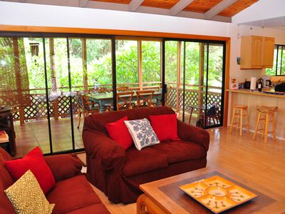 Comfortable living room, adjoined to a screened-in Lanai for dining.