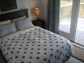 Galveston house photo - Inviting second bedroom feels like a master suite also opens to deck