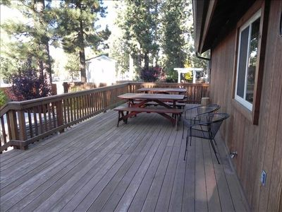 Custom made picnic tables on to back deck for comfortable outdoor dining.