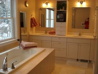 Master bathroom with double sinks, glass shower & jetted  tub. Overlooks garden.