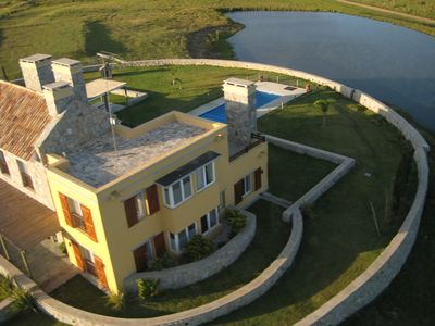 View Las Gurisas Villa & private lagoon in Jose Ignacio from helicopter
